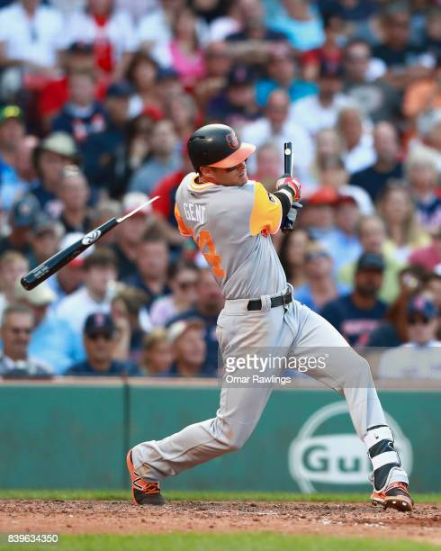 Craig Gentry of the Baltimore Orioles bat breaks while at bat in the top of the seventh inning during the game against the Boston Red Sox at Fenway...