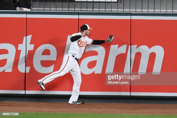 Craig Gentry of the Baltimore Orioles catches a fly ball during a baseball game against the Washington Nationals at Oriole Park at Camden Yards on...