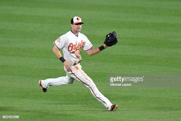 Craig Gentry of the Baltimore Orioles catches a fly ball during a baseball game against the Cleveland Indians at Oriole Park at Camden Yards on June...