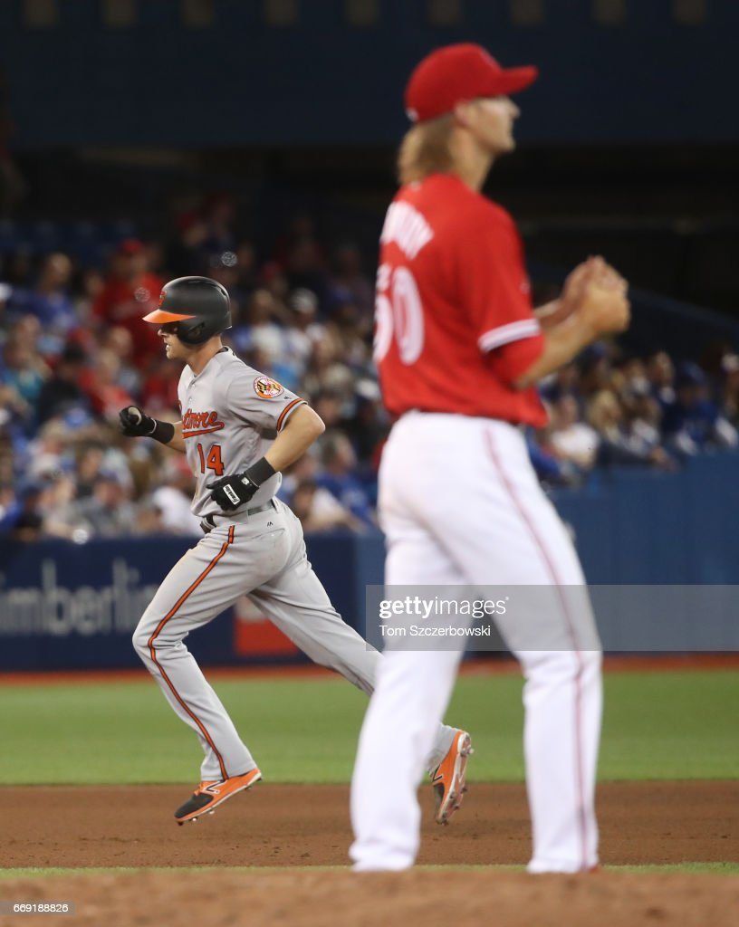 Craig Gentry #14 of the Baltimore Orioles circles the bases after hitting a two-run home run in the eighth inning during MLB game action as Matt Dermody #50 of the Toronto Blue Jays reacts at Rogers Centre on April 16, 2017 in Toronto, Canada.