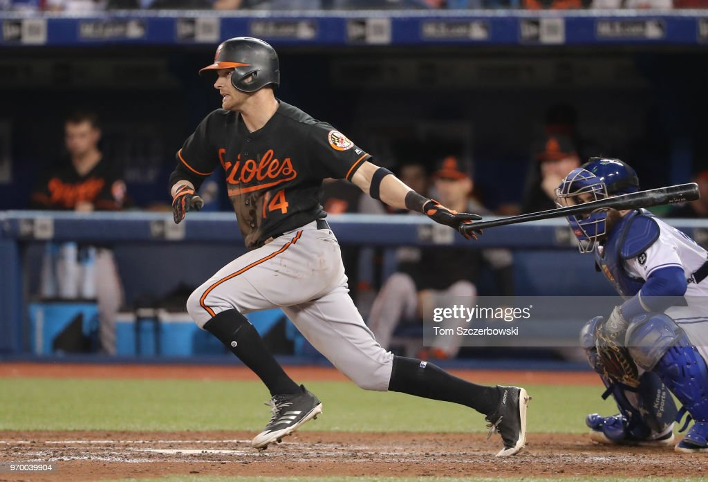 Craig Gentry #14 of the Baltimore Orioles hits a single in the eighth inning during MLB game action against the Toronto Blue Jays at Rogers Centre on June 8, 2018 in Toronto, Canada.