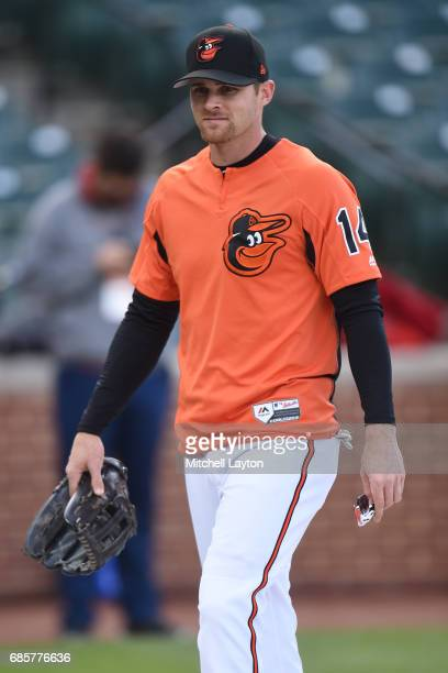 Craig Gentry of the Baltimore Orioles looks on during batting practice of a baseball game against the Washington Nationals at Oriole Park at Camden...