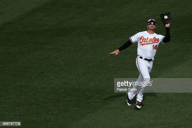 Craig Gentry of the Baltimore Orioles makes a catch against the Minnesota Twins during the first inning in their Opening Day game at Oriole Park at...