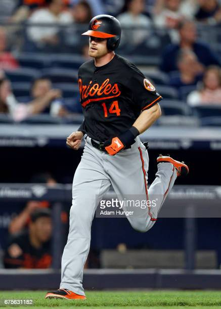 Craig Gentry of the Baltimore Orioles runs home against the New York Yankees at Yankee Stadium on April 28 2017 in the Bronx borough of New York City...