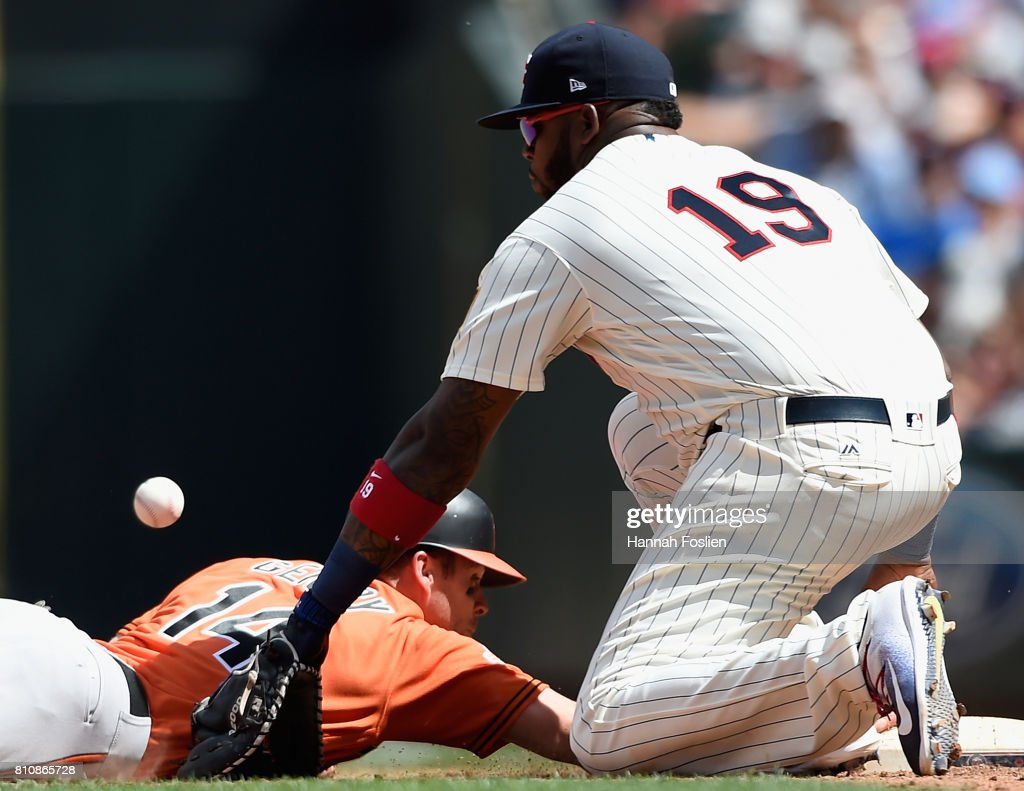 Craig Gentry #14 of the Baltimore Orioles slides safely back to first base as Kennys Vargas #19 of the Minnesota Twins is unable to field the ball during the seventh inning of the game on July 8, 2017 at Target Field in Minneapolis, Minnesota. Gentry reached third base on the play. The Orioles defeated the Twins 5-1.