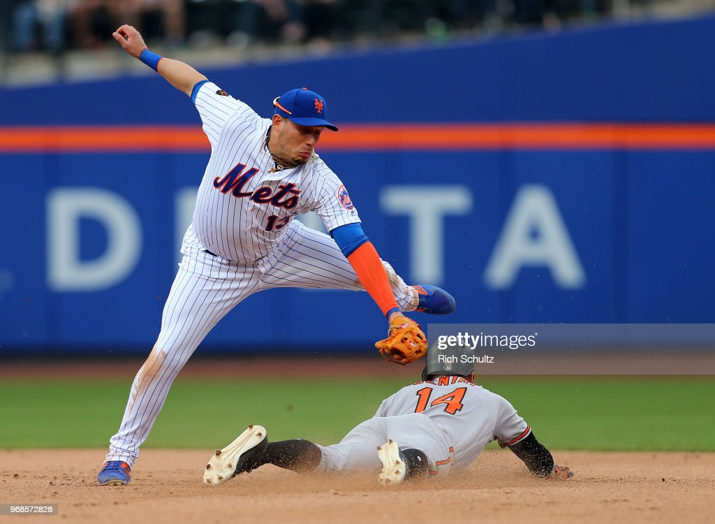 Craig Gentry #14 of the Baltimore Orioles steals second base ahead of the tag by Asdrubal Cabrera #13 of the New York Mets in the eighth inning of a game at Citi Field on June 6, 2018 in the Flushing neighborhood of the Queens borough of New York City. The Orioles defeated the Mets 1-0.