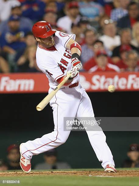 Craig Gentry of the Los Angeles Angels of Anaheim hits a single to bring in Yunel Escobar with the Angels' first run of the season in the sixth...