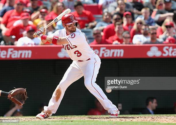 Craig Gentry of the Los Angeles Angels of Anaheim is hit by a pitch thrown by Martin Perez of the Texas Rangers in the seventh inning at Angel...