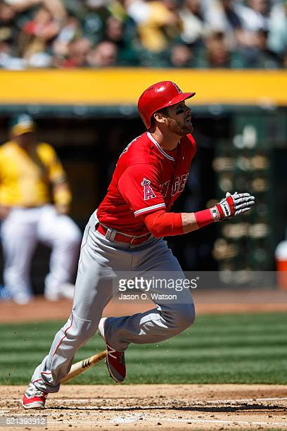 Craig Gentry of the Los Angeles Angels of Anaheim runs to first base after an at bat against the Oakland Athletics during the second inning at the...