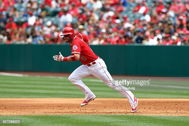 Craig Gentry of the Los Angeles Angels runs from first to second base during the game against the Seattle Mariners at Angel Stadium of Anaheim on...