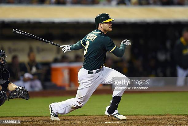 Craig Gentry of the Oakland Athletics bats against the Seattle Mariners at Oco Coliseum on May 6 2014 in Oakland California Core Hart of the Mariners...