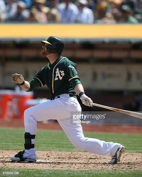 Craig Gentry of the Oakland Athletics bats against the Seattle Mariners during the game at Oco Coliseum on Saturday April 11 2015 in Oakland...