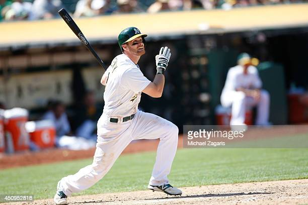 Craig Gentry of the Oakland Athletics bats during the game against the Los Angeles Angels of Anaheim at Oco Coliseum on June 1 2014 in Oakland...