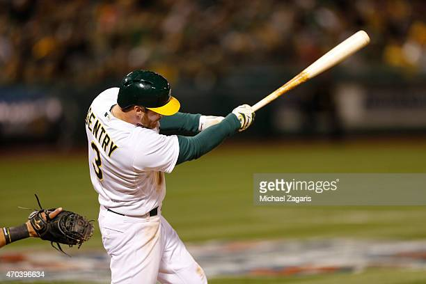 Craig Gentry of the Oakland Athletics bats during the game against the Texas Rangers at Oco Coliseum on April 8 2015 in Oakland California The...