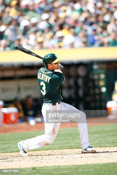 Craig Gentry of the Oakland Athletics bats during the game against the Houston Astros at Oco Coliseum on April 19 2014 in Oakland California The...