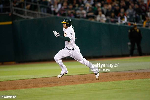 Craig Gentry of the Oakland Athletics runs the bases during the game against the San Francisco Giants at Oco Coliseum on July 8 2014 in Oakland...