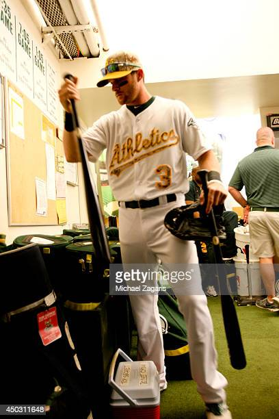 Craig Gentry of the Oakland Athletics selects his bats in the clubhouse prior to the game against the Detroit Tigers at Oco Coliseum on May 26 2014...