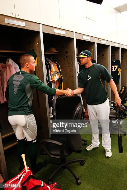 Craig Gentry of the Oakland Athletics welcomes Athletics first round draft pick Matt Chapman in the clubhouse prior to the game against the Texas...