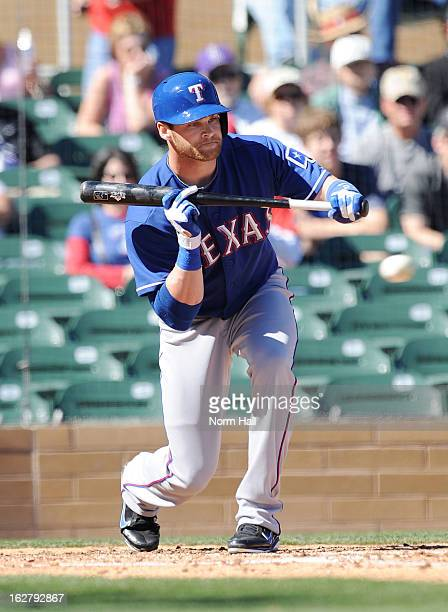 Craig Gentry of the Texas Rangers attempts to bunt the ball against the Colorado Rockies during a spring training game at Salt River Field on...