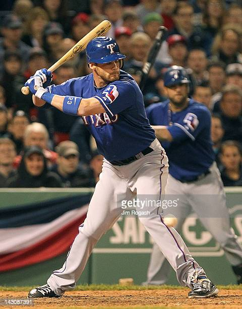 Craig Gentry of the Texas Rangers gets hit in the knee to knock in a run with bases load in the 8th inning against the Boston Red Sox at Fenway Park...