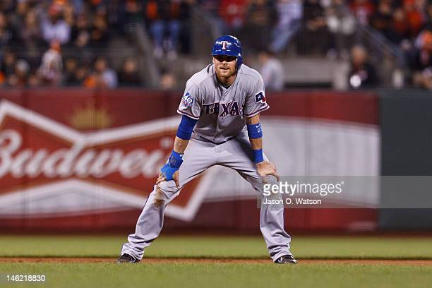 Craig Gentry of the Texas Rangers leads off second base against the San Francisco Giants during the sixth inning of an interleague game at ATT Park...