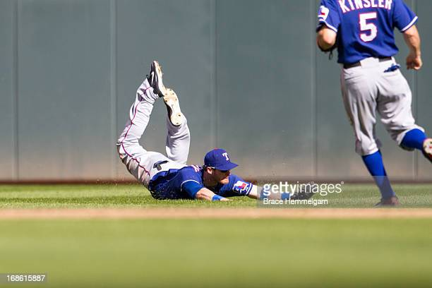 Craig Gentry of the Texas Rangers makes a diving catch against the Minnesota Twins on April 27 2013 at Target Field in Minneapolis Minnesota The...