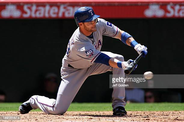 Craig Gentry of the Texas Rangers misses the ball on a bunt attempt against the Los Angeles Angels of Anaheim in the sixth inning at Angel Stadium of...