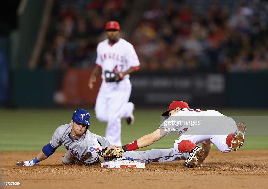 Craig Gentry #23 of the Texas Rangers slides safely past the tag of shortstop Brendan Harris #20 of the Los Angeles Angels of Anaheim and steals second base in the second inning at Angel Stadium of Anaheim on April 24, 2013 in Anaheim, California.