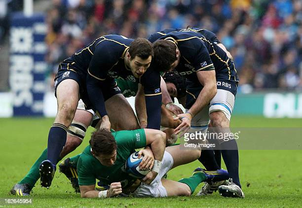 Craig Gilroy of Ireland is tackled by Tim Visser and Johnnie Beattie of Scotland during the RBS Six Nations match between Scotland and Ireland at...