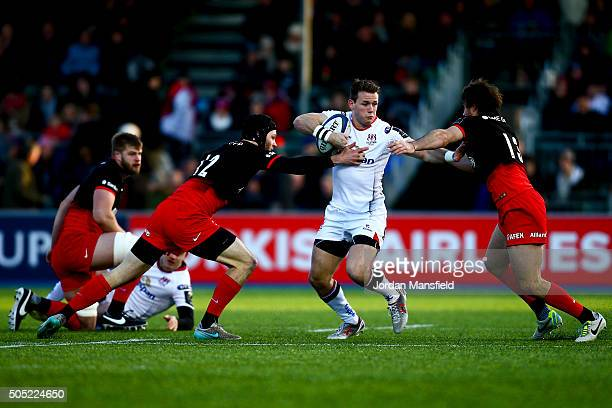 Craig Gilroy of Ulster is tackled by Duncan Taylor and Marcelo Bosch of Saracens during the European Rugby Champions Cup match between Saracens and...