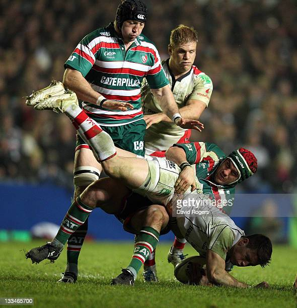 Craig Gilroy of Ulster is tackled by Marcos Ayerza during the Heineken Cup match between Leicester Tigers and Ulster at Welford Road on November 19...