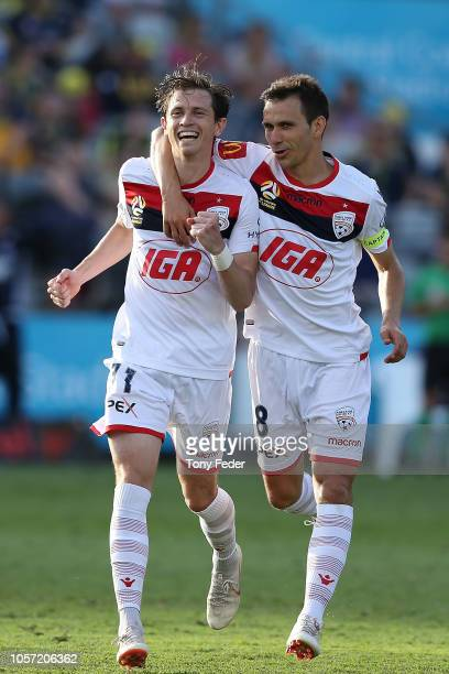 Craig Goodwin and Isaias of Adelaide celebrate a goal during the round three A-League match between the Central Coast Mariners and Adelaide United at...