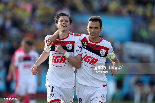 Craig Goodwin and Isaias of Adelaide celebrate a goal during the round three ALeague match between the Central Coast Mariners and Adelaide United at...