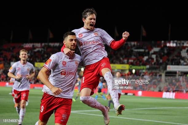 Craig Goodwin of Adelaide United and Tomi Juric of Adelaide United celebrate during the A-League match between Adelaide United and Macarthur FC at...