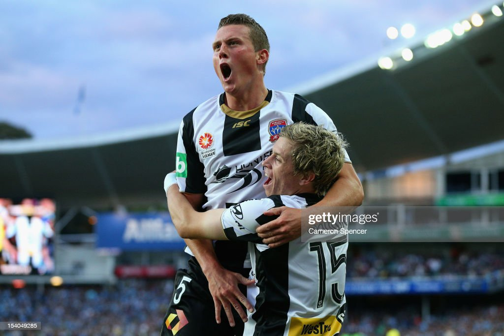 Craig Goodwin of Newcastle celebrates kicking a goal with team mate Dominik Ritter during the round two A-League match between Sydney FC and the Newcastle Jets at Allianz Stadium on October 13, 2012 in Sydney, Australia.