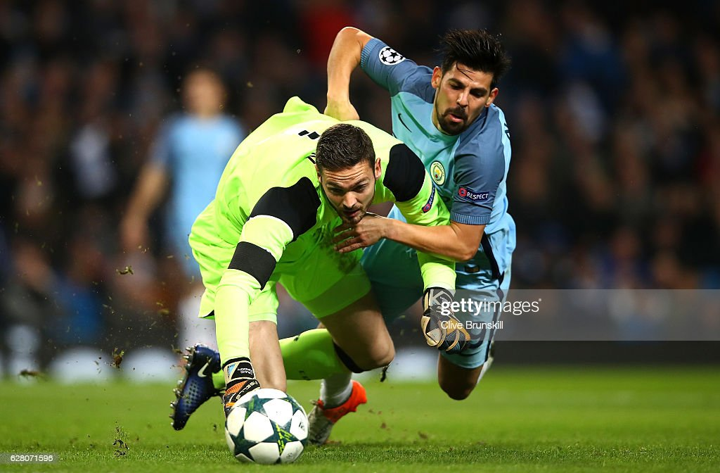 Craig Gordon of Celtic (L) and Nolito of Manchester City (R) both challenge for the ball during the UEFA Champions League Group C match between Manchester City FC and Celtic FC at Etihad Stadium on December 6, 2016 in Manchester, England.