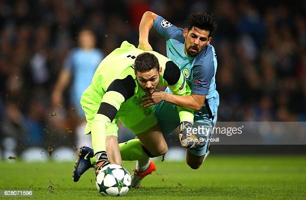 Craig Gordon of Celtic and Nolito of Manchester City both challenge for the ball during the UEFA Champions League Group C match between Manchester...