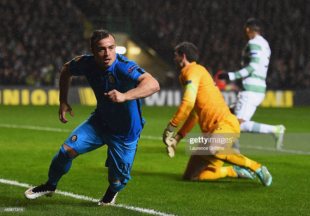 Craig Gordon of Celtic looks dejected as Xherdan Shaqiri of Inter Milan celebrates as he scores their first goal during the UEFA Europa League Round of 32 first leg match between Celtic FC and FC Internazionale Milano at Celtic Park Stadium on February 19, 2015 in Glasgow, United Kingdom.