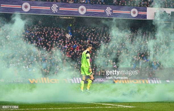 Craig Gordon of Celtic walks among smokes as a flare is thrown in after Celtic's first goal during the Ladbrokes Scottish Premiership match between...