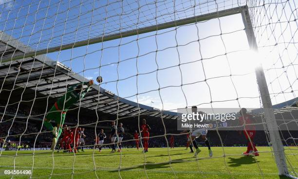 Craig Gordon of Scotland makes a save during the FIFA 2018 World Cup Qualifier between Scotland and England at Hampden Park National Stadium on June...