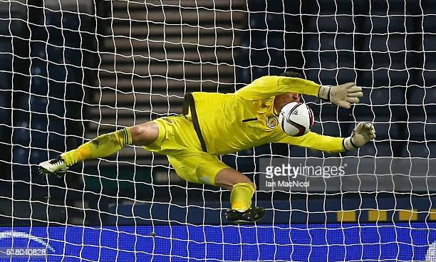 Craig Gordon of Scotland saves from Martin Braithwaite of Denmark during the International Friendly match between Scotland and Denmark at Hampden...