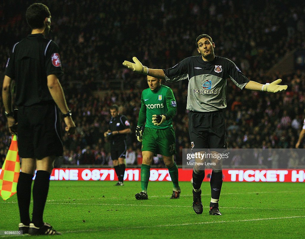 Craig Gordon of Sunderland comes to the linesman, during the penalty shoot out during the Carling Cup 4th Round match between Sunderland and Aston Villa at the Stadium of Light on October 27, 2009 in Sunderland, England.