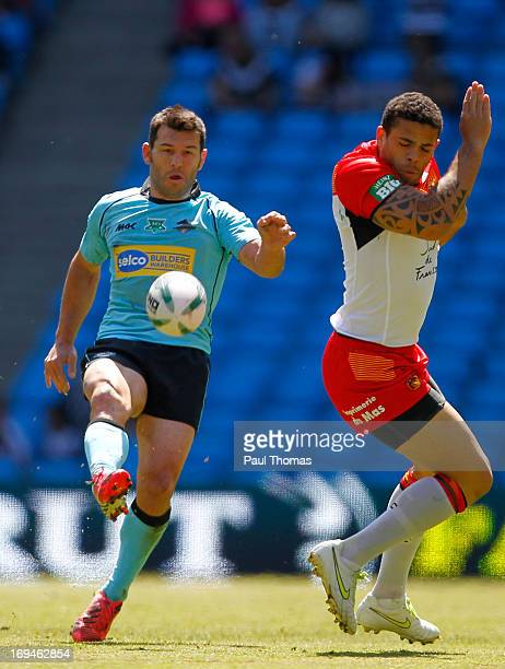 Craig Gower of the Broncos kicks past Kevin Larroyer of the Dragons during the Super League Magic Weekend match between Catalan Dragons and London...