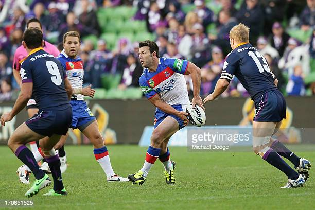 Craig Gower of the Knights looks to pass the ball during the round 14 NRL match between the Melbourne Storm and the Newcastle Knights at AAMI Park on...
