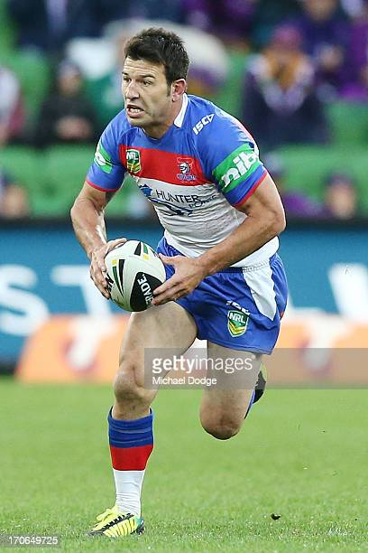 Craig Gower of the Knights runs with the ball during the round 14 NRL match between the Melbourne Storm and the Newcastle Knights at AAMI Park on...
