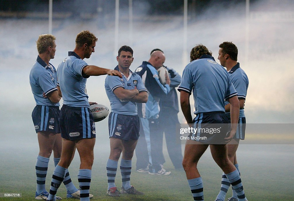 Craig Gower talks with team mates during the NSW Blues, State Of Origin training held at the Sydney Cricket Ground, May 17, 2004 in Sydney, Australia.