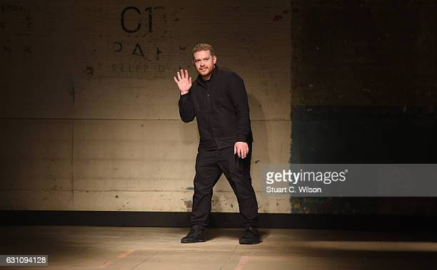 Craig Green gestures to guests following his runway show during London Fashion Week Men's January 2017 collections at Topman Show Space on January 6...