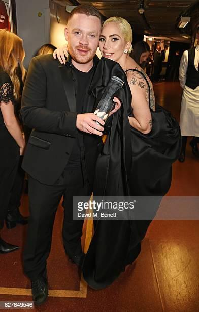Craig Green winner of the British Menswear Designer award and Lady Gaga pose backstage at The Fashion Awards 2016 at Royal Albert Hall on December 5...