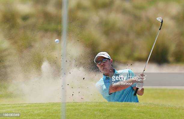 Craig Hancock of Tasmania plays out of a bunker on the 11th hole during day two of the Australia Masters at Kingston Heath Golf Club on November 16,...