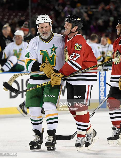 Craig Hartsburg of the Minnesota North Stars Alumni speaks with Jeremy Roenick of the Chicago Blackhawks Alumni after the alumni game at the 2016...